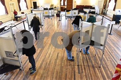 Photo by Jon Olender West Rutland voters take advantage of the noon lunch hour to cast their votes at the West Rutland Town Hall on Tuesday.