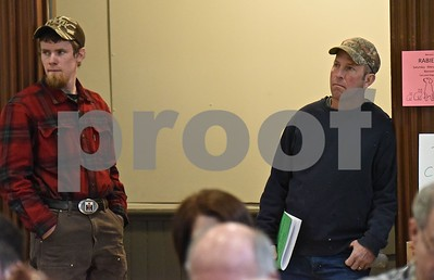 Photo by Jon Olender Jake Ambrozaitis, left, and his father Bob listen in to items being voted on at Benson's Town Meeting on Tuesday morning.