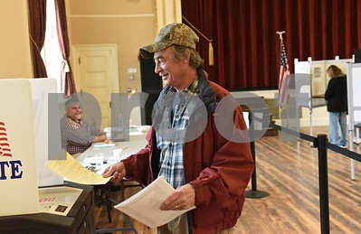 Photo by Jon Olender John Buck casts his ballots while voting on Tuesday at the West Rutland Town Hall.