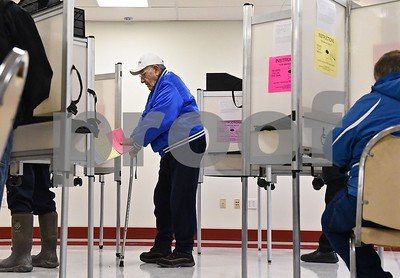 Photo by Jon Olender  Castleton resident Ben Boss makes his way from the voting booth to cast his ballot on Tuesday at the Castleton Public Safety Building.