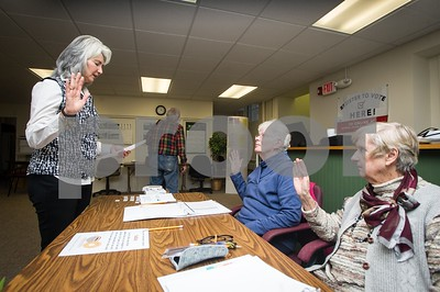 Robert Layman / Staff Photo Killington Town Clerk Lucrecia Wonsor, left, swears in ballot clerks Beverly Anderson, left, and Louise Hansson, right Tuesday afternoon.