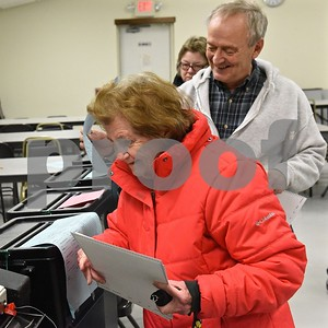 Photo by Jon Olender Fair Haven residents Kay Petty, front, and Norm Vadnais cast their ballots on Tuesday at the Fair Haven American Legion.