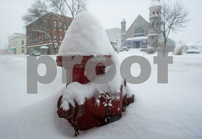 Robert Layman / Staff Photo A fire hydrant collects snow during Tuesday's blizzard.