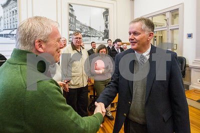 Robert Layman / Staff Photo Allaire shakes hands with people shortly after giving his induction speech Wednesday morning.