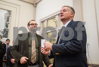 Robert Layman / Staff Photo Rutland City Mayor Dave Allaire, right, delivers his letter of resignation from the outgoing Board of Alderman to presdient Will Notte shortly before taking the mayoral oath Tuesday morning at City Hall.