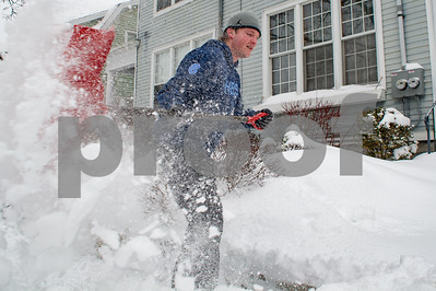 Robert Layman / Staff Photo Bobby Dazi clears out snow in front of his parents house off of Church Street in Rutland Wednesday morning.