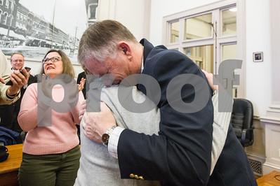 Robert Layman / Staff Photo Rutland City Mayor Dave Allaire hugs incoming Board of Alderman President  Sharon Davis Wednesday morning.