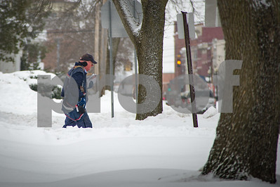 Robert Layman / Staff Photo A postal carrier does his rounds in Rutland City Tuesday morning.