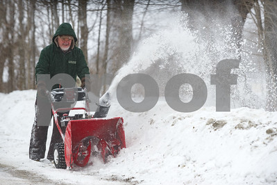 Robert Layman / Staff Photo Tony Peffer clears snow outside his home in West Rutland Wedensday morning.