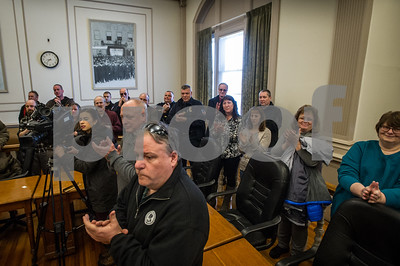 Robert Layman / Staff Photo Attendees clap after Dave Allaire takes his mayoral oath at City Hall Wednesday morning.