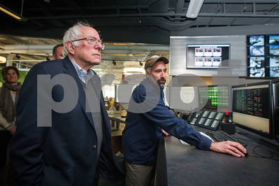 Robert Layman / Staff Photo Senator Bernie Sanders views a demonstration by Matt Ethier during his visit to Green Mountain Power Friday afternoon.