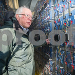 Robert Layman / Staff Photo Senator Bernie Sanders tours a lithium-ion battery storage container at the Green Mountain Power solar farm in Rutland Friday afternoon.