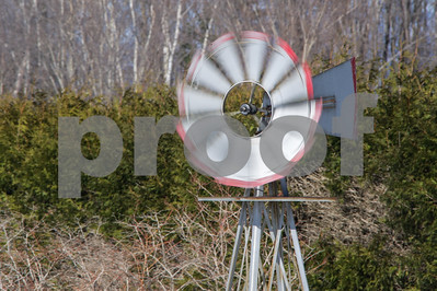 Robert Layman / Staff Photo A small windmill fan spins fast during Wednesday's gusts.