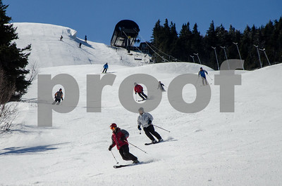 Robert Layman / Staff Photo Skiers take to a sunny Superstar trail at Killington Ski Resort Thursday morning.