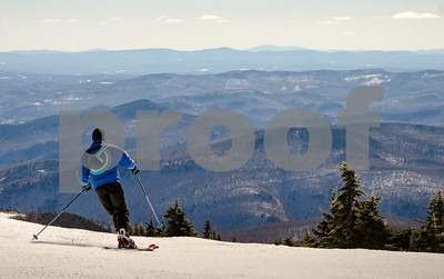 Robert Layman / Staff Photo A skier rides off the peak and onto the trails at Killington Ski Resort Thursday morning.