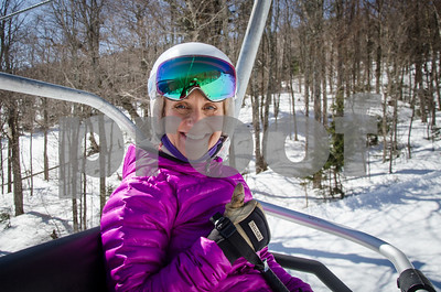 Robert Layman / Staff Photo  Donna Weinbrecht, olympic gold medalist in Mogul skiing, rides up the Skye Peak chair lift at Killington Thursday morning -- giving a thumbs up for the great spring skiing conditions.
