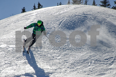 Robert Layman / Staff Photo A skier rides the edges of the Superstar  trail at Killington Thursday morning.