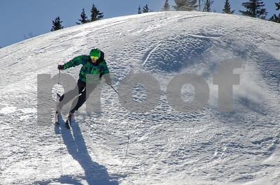 Robert Layman / Staff Photo A skier rides the edges of the Superstar  trail at Killington Thursday morning.