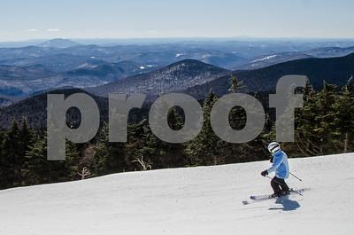 Robert Layman / Staff Photo A skier rides off the peak and onto the trails at Killington Ski Resort Thursday morning.