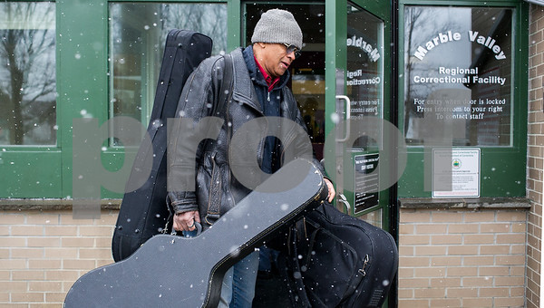 "Robert Layman / Staff Photo Blues musician Guy Davis carries three guitars inside the Marble Valley Regional Correctional Facility in Rutland Friday afternoon. Davis and harmonica player  Fabrizio Poggi  performed a short set for the inmates and staff. In an interview with Herald's George Nostrand earlier this week, Davis said ""I believe in the power of human beings to over come...I all look forward to all audiences. They feed me. They feed my soul."""