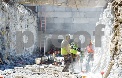 Robert Layman / Staff Photo Laborers for Gendron Concrete work on the culvert project in Brandon Tuesday morning.