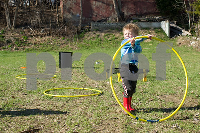 Robert Layman / Staff Photo Colton Gladding plays with a hula hoop at the Spring Craft Party in Rutland Tuesday afternoon.