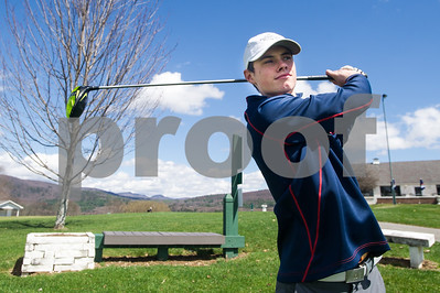 Robert Layman / Staff Photo Proctor High Senior Nick Ojala enjoys a spring day at the Proctor-Pittsford Country Club Monday April 17.