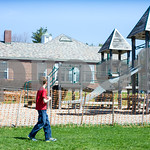 Robert Layman / Staff Photo A student from Barstow Memorial School in Chittenden walks by a closed playground area during recess Monday morning. Students at the school have been without play ...
