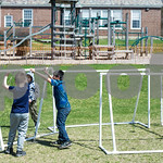 Robert Layman / Staff Photo Shortly before roasting imaginary smoreds, a  group of boys pull together soccer goals during their fort building process. Teachers at the school said the news of ...