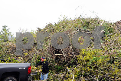 Robert Layman / Staff Photo  The Rutland Transfer Station saw a good portion of the debris removal from Friday night's storm. Seen here, a resident removes a truck load of brush cleared from his property after the storm.