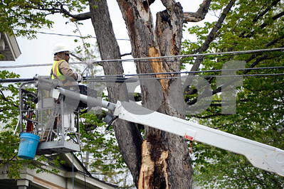 Robert Layman / Staff Photo  An employee from Eustis Cable Enterprises makes repairs to utility lines spanning across West Street Monday afternoon.