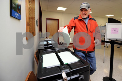 Robert Layman / Staff Photo  Ted Molnar of Castleton casts his ballot during Act 46 voting in Castleton Tuesday afternoon.