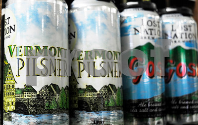 Robert Layman / Staff Photo  A four pack of Lost Nation's Vermont Pilsner is seen shelved at the Rutland Area Food Co-Op. The Morrisville-based brewery is among many in Vermont's craft beer scene that include the state name in the beer's title.