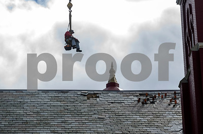A roofer from Vermont Roofing is