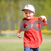 Robert Layman / Staff Photo Nolan Alberty, 5 of Cavendish, runs back to the crowd after throwing an opening pitch for the Black River and Long Trail varsity baseball game in Ludlow Tuesday night.