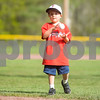 Robert Layman / Staff Photo Nolan Alberty, 5, of Cavendish, tosses a baseball after throwing the opening pitch for the Black River and Long Trail varsity baseball game Tuesday night.