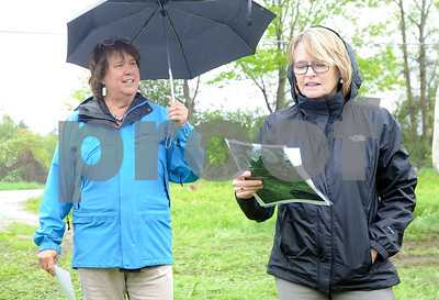 Robert Layman / Staff Photo Sarah Hofmann, left, and Margaret Cheney of the Vermont Public Service Board adress the crowd of people gathered to tour the projected solar site in Rutland Town Monday afternoon.