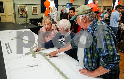 Robert Layman / Staff Photo The town of Brandon hosted the Route 7 Kick-Off Palooza Sunday afternoon at the town hall. The event helped residents ask questions and adress concerns to town officials and Casella Construction -- the company awarded the contract for the segment six project. Seen here, a group of vistors analyze a long construction map for the project.