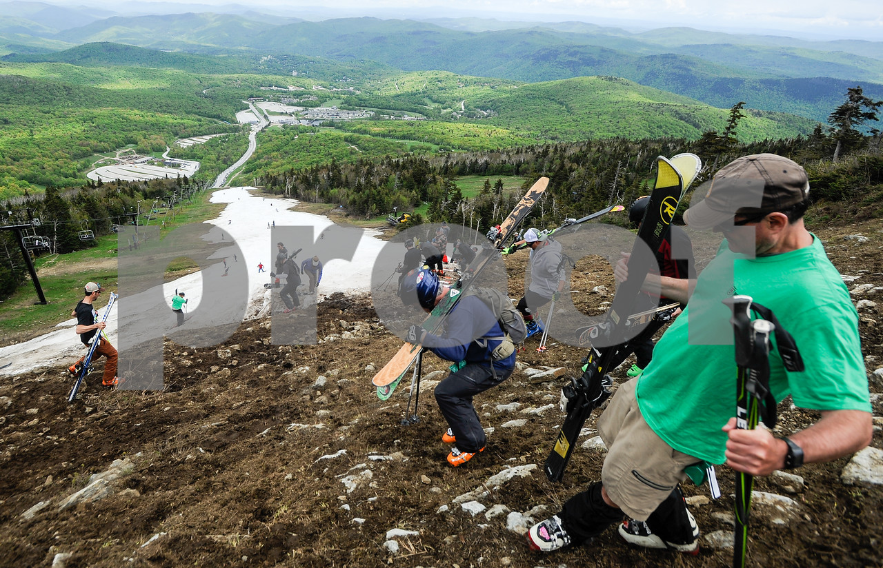 Robert Layman / Staff Photo Skiers make the difficult -- but rewarding -- trek to the top of the Superstar trail at Killington Mountain Resort Thursday afternoon. The resort issued free lift tickets for their final day of the winter season.