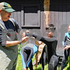 Robert Layman / Staff Photo USFS volunteer Alex Pelletier helps Newton School fifth grader Maddox Castro get into his wetsuit before snorkeling in the White River Wednesday June 7 2017.