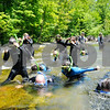 Robert Layman / Staff Photo Fifth graders from the Newton School look through the waters of the White River in Rochester Wednesday June 7 2017.