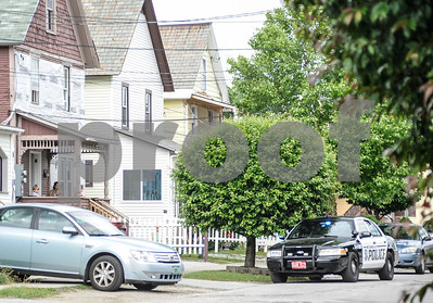 Robert Layman / Staff Photo A K-9 police cruisuer sits outside a house on School Street in Rutland Thursday afternoon.