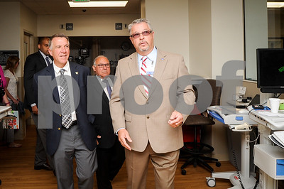 Robert Layman / Staff Photo Emergency Department Director Thomas Rounds, right, walks Phil Scott and others on a tour of the new $6 million facility Thursday morning during the opening ceremony.