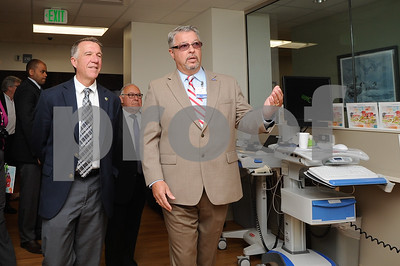 Robert Layman / Staff Photo Emergency Department Director Thomas Rounds, right, walks Vermont Governor Phil Scott and others on a tour of the new $6 million facility Thursday morning during the opening ceremony.
