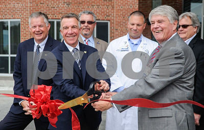 Robert Layman / Staff Photo Vermont Goverrnor Phil Scott center, left, cutting the ribon with Tom Huebner, president for the Rutland Regional Medical Center, at the opening ceremony for the facility's new emergency room, June 29, 2017.