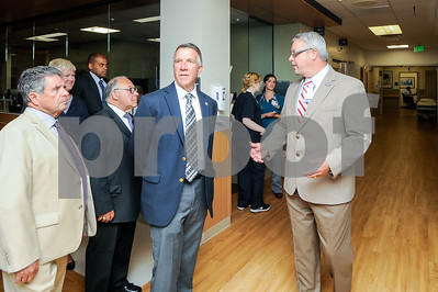 Robert Layman / Staff Photo Emergency Department Director Thomas Rounds, right, walks Vermont Governor Phil Scott, center, and others on a tour of the new $6 million facility Thursday morning during the opening ceremony.