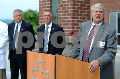 Robert Layman / Staff Photo Rutland Regional Medcial Center President Tom Huebner, right, speaks during the opening ceremony of the facility's new emergency room Thursday June 29, 2017.