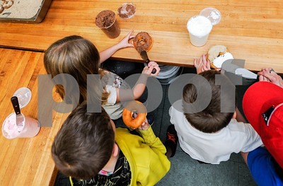 Robert Layman / Staff Photo As a reward for their good behavior, kids were allowed to ice their own donuts.