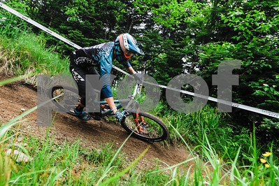 Robert Layman / Staff Photo A mountain biker rides the burm on the Scarecrow trail at Killington Resort Friday afternoon.