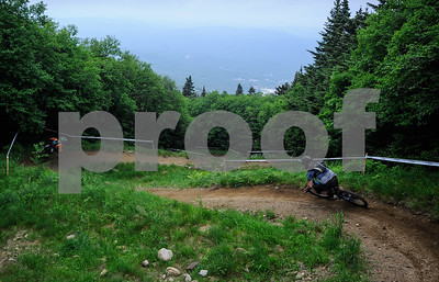Robert Layman / Staff Photo Bikers ride through the top of Scarecrow Trail at killington while training for the Eastern States Cup Clif Enduro Race Friday afternoon.